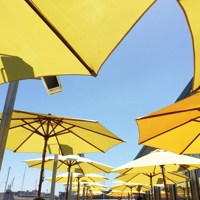Yellow umbrellas at Mission Rock Resort in SF