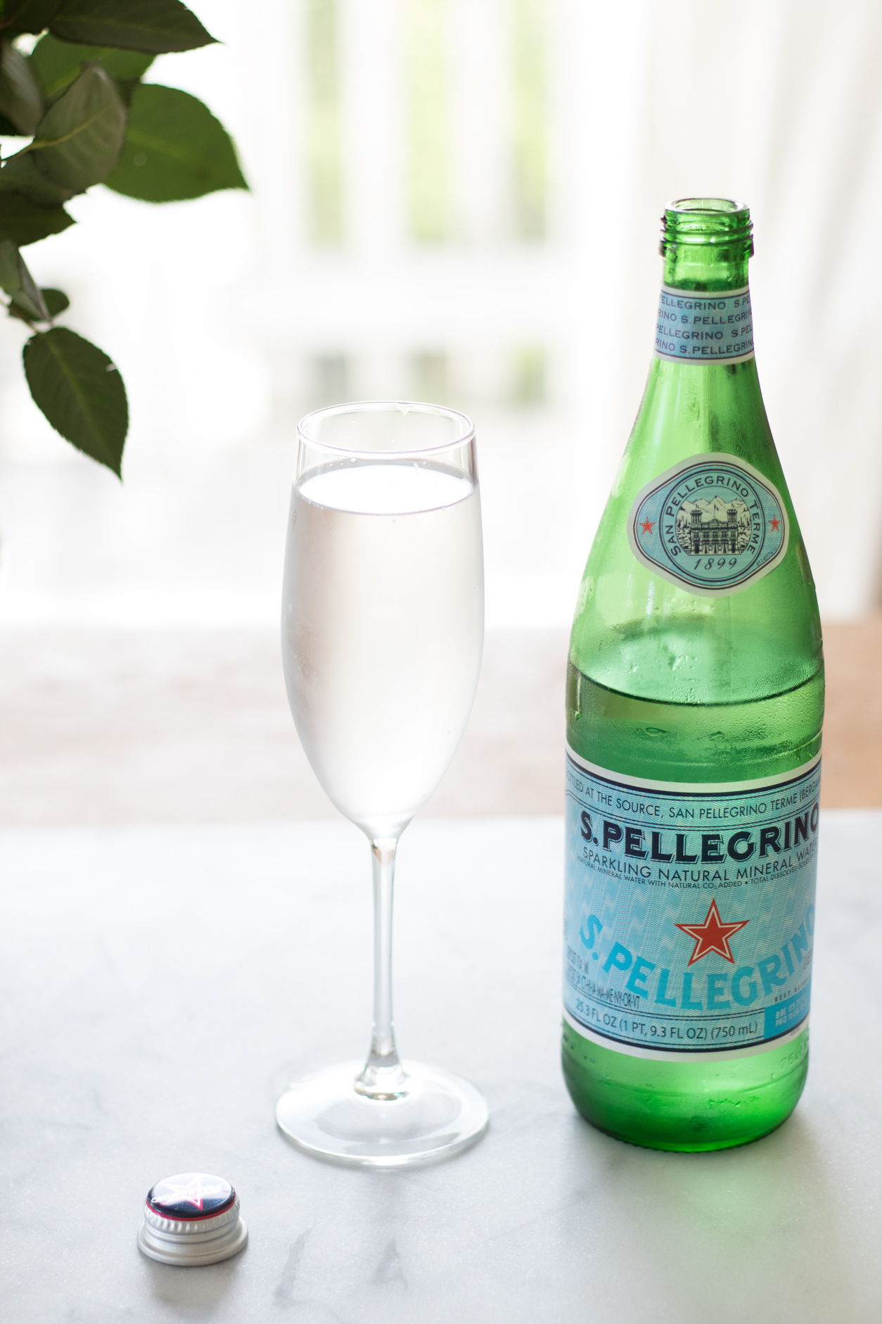 How to drink more water_Pellegrino, champ glass, cap
